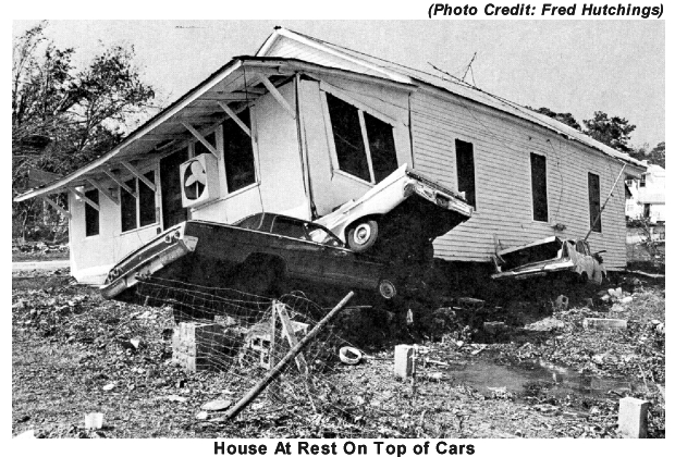 House At Rest On Top of Cars in Point Cadet, Mississippi (Photo Credit: Fred Hutchings)